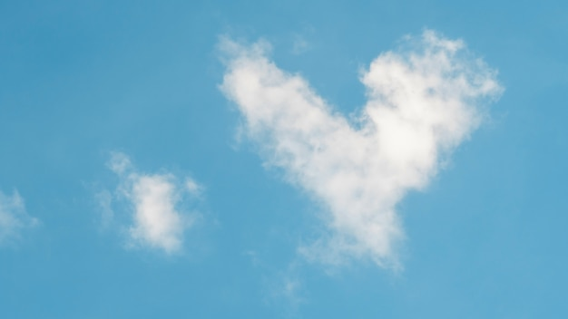 Cloud in a heart shape on a blue background.
