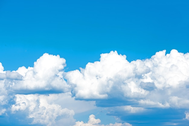 Cloud overcast sky blue or azure sky bright daytime summer. everything lies above surface atmosphere outer space is sky. cloud is aerosol comprising visible mass of liquid droplets frozen in air.