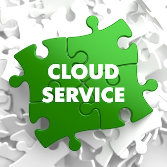 Cloud service on green puzzle on white background.
