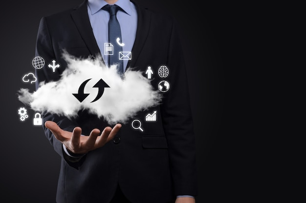 Cloud technology. cloud storage sign with two arrows up and down on dark . cloud computing, big data center, future infrastructure, digital ai concept. virtual hosting symbol