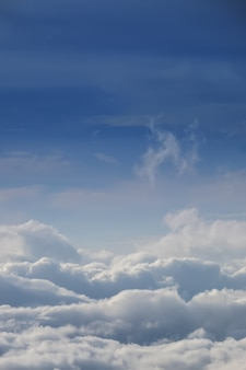 Cloud texture wallpaper. view of blue sky and cloudy field from airplane window.