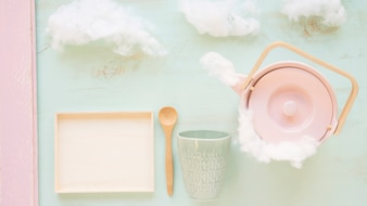 Clouds and cookery utensil against color background