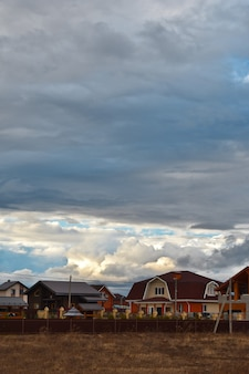 Clouds are flying over the cottage village