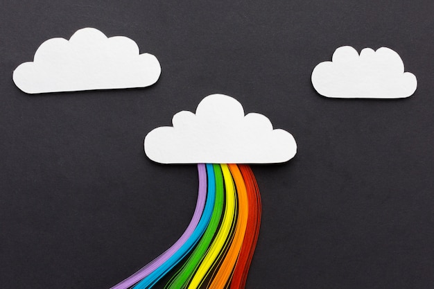 Clouds on black background and rainbow