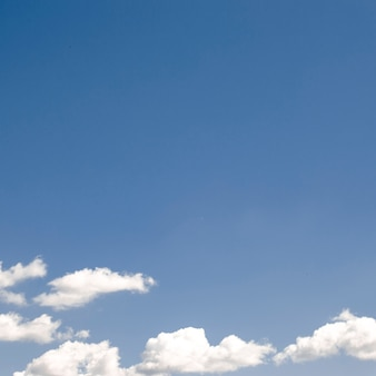 Clouds on the blue clear sky