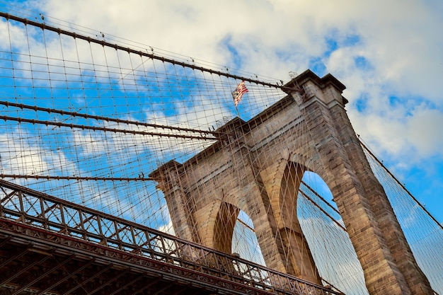 Clouds above brooklyn bridge, wide angle view - new york brooklyn bridge pylon