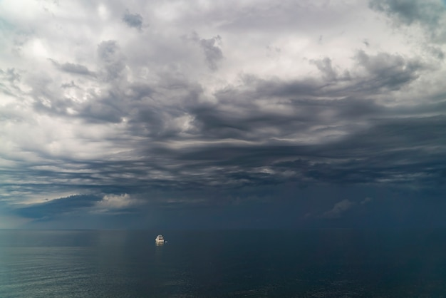 Clouds gather over the sea before a thunderstorm near the coast in crimea .