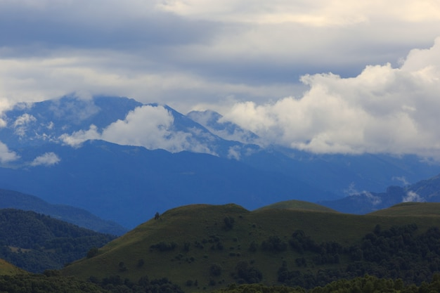 Clouds over the hills in the area of mount elbrus. photographed in the caucasus, russia.