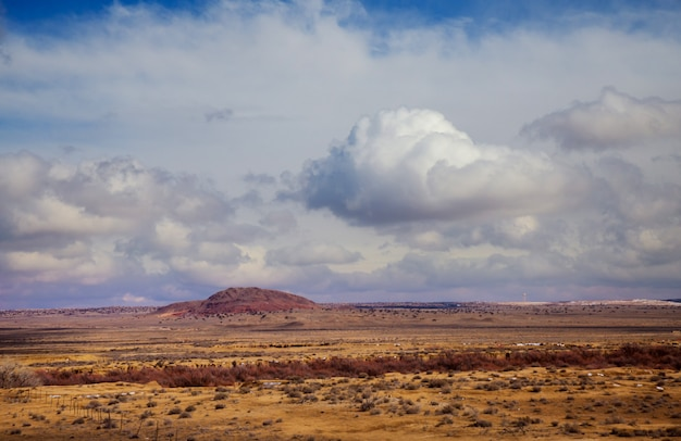 Clouds over new mexico red rock landscape, southwest usa