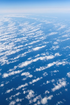 Clouds and sky view from airplane window.