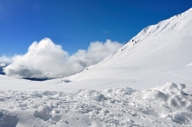 Clouds and snow in hight mountain in winter on blue sky