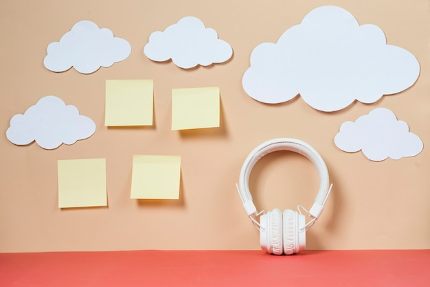 Clouds and sticky notes near headphones