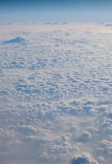 Clouds texture wallpaper. view of blue sky and cloud field from airplane window. ariel lanscape of s