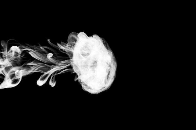 Clouds of white smoke on a black background