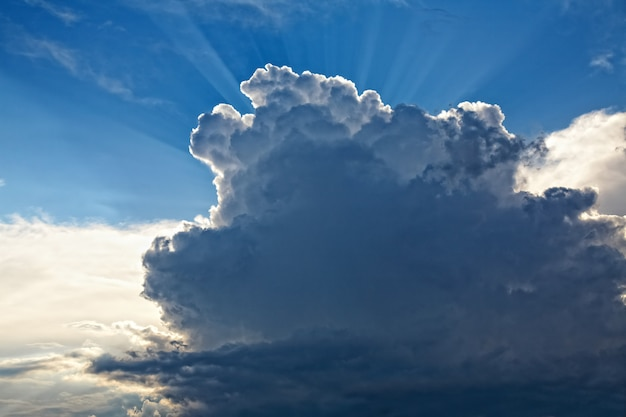Cloudscape and sunbeams before thunderstorm