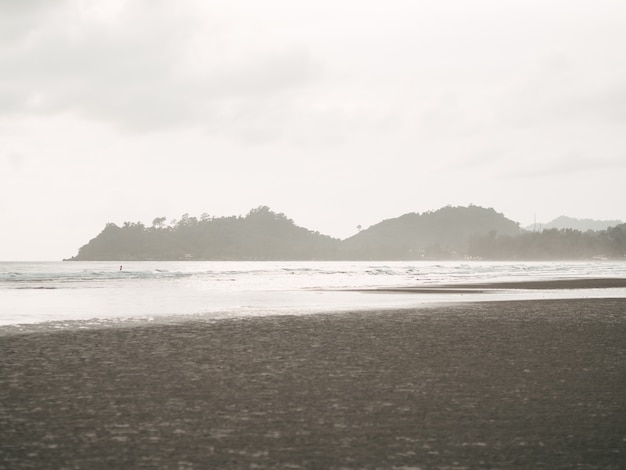 Cloudy beach with thunder storm comes to the island.