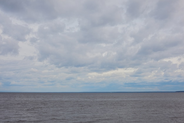 Cloudy clouds over gray water.