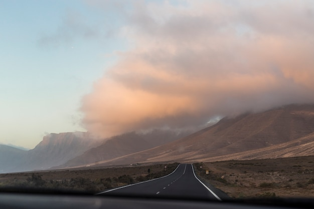 Cloudy day and road as travel background. desert. trip. holidays