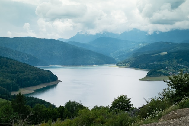 Cloudy landscape view from lake bicaz in romania