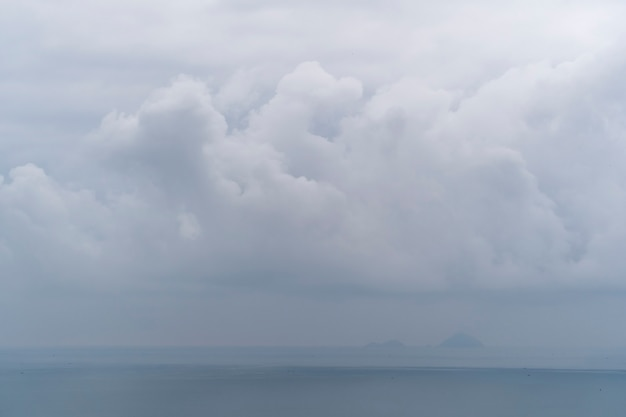 Cloudy morning over sea water. landscape sunrise on hon chong cape, nha trang, khanh hoa province, vietnam. travel and nature concept. overcast morning, clouds and sea water