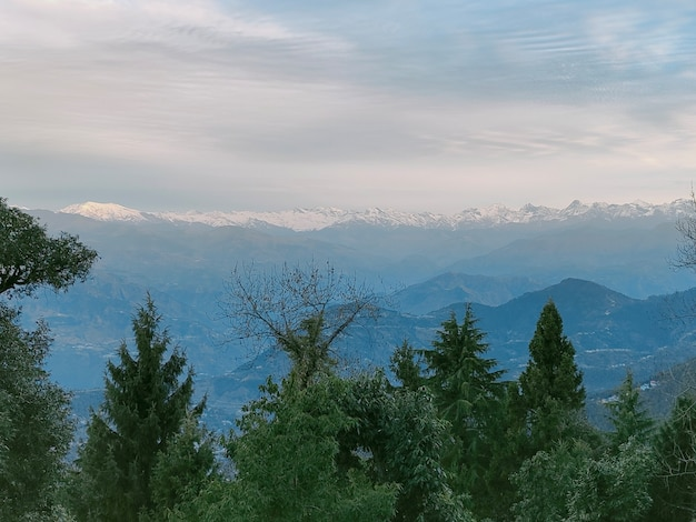 Cloudy sky mountains trees forest  morning at dalhousie hill station in himachal pradesh india