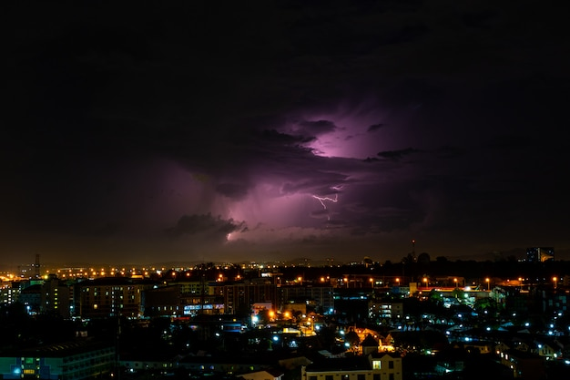Cloudy with bright lightning bolt strikes in the rural landscape of small city