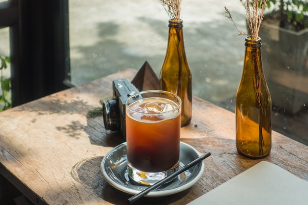 Clouse up fresh ice coffee (cold americano) in coffee shop background