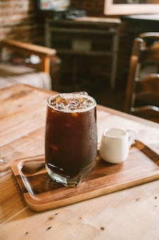 Clouse up fresh ice coffee (cold americano) in coffee shop background.