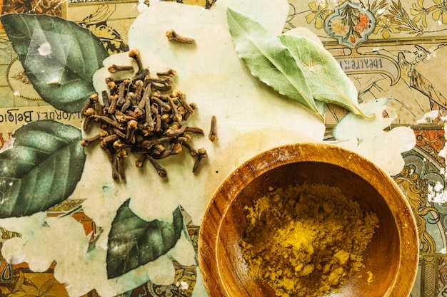 Cloves and bay leaves lying near turmeric