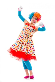 Clown in colorful wig showing not ok sign, looking at front