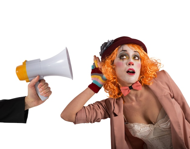 Clown hears a megaphone with alert expression