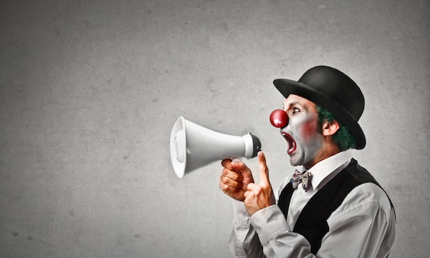Clown shouting into a megaphone
