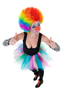 Clown showing ok sign with her fingers isolated on white