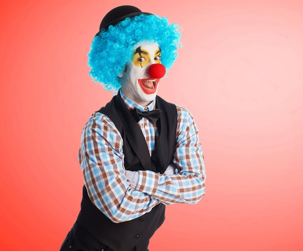 Clown smiling with arms crossed