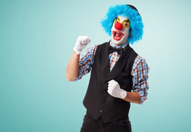 Clown smiling with a fist high