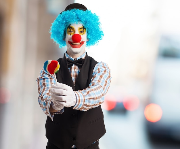 Clown smiling with a lollipop