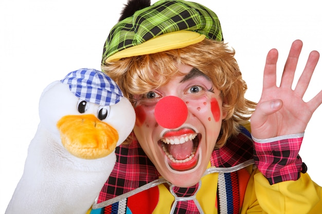 Clown with duck and makeup isolated on white background