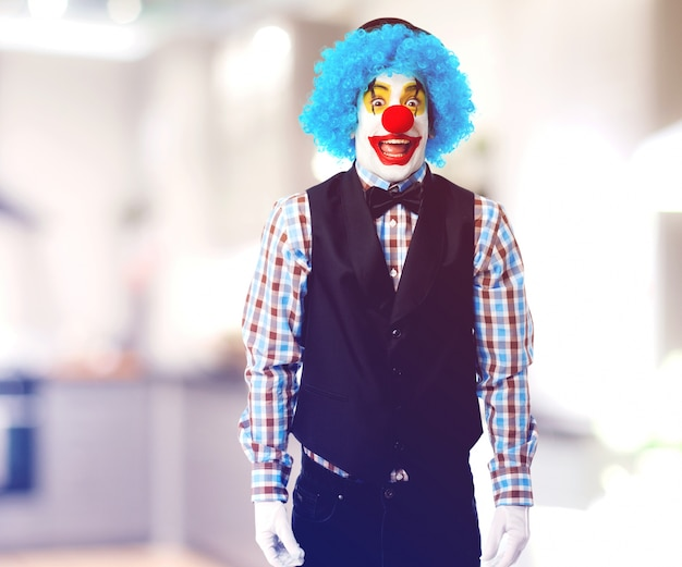 Clown with fallen arms smiling