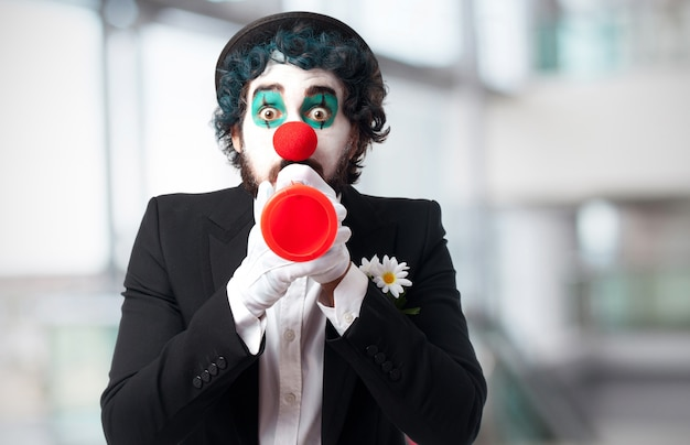Clown with a toy trumpet