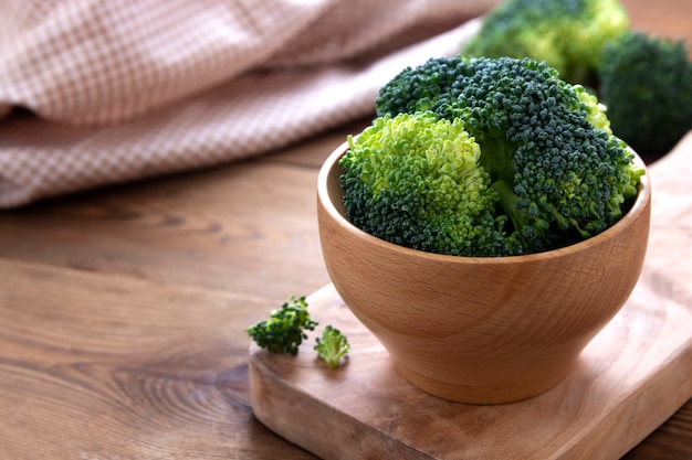 Clsoe up broccoli over wooden table. healthy food. copy space.
