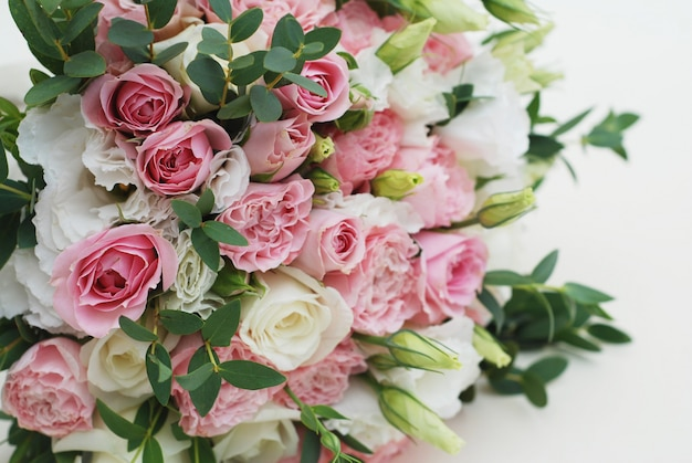 Clsoeup wedding, bridal bouquet with pink roses and eucaliptus.
