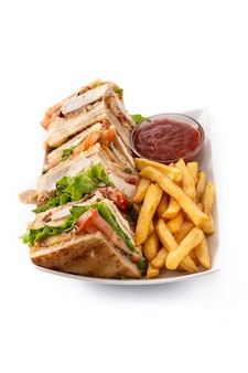 Club sandwich and french fries isolated