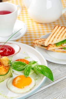 Club sandwich panini with ham, tomato, cheese and basil with cheese balls