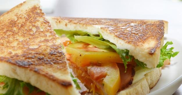 Club sandwich with coffee on wood background