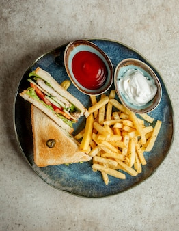 Club sandwich with french fries _