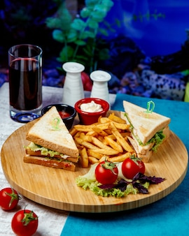 Club sandwich with fries and tomatoes