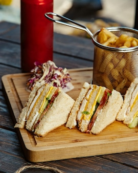 Club sandwich with ham chicken eggs prickles cucumber tomato and lettuce
