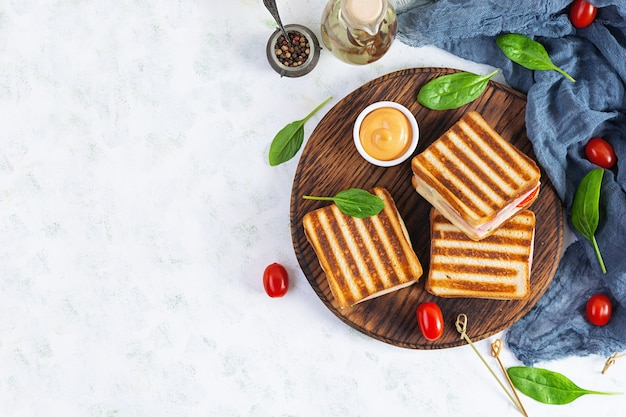 Club sandwich with ham, tomato, cheese and spinach