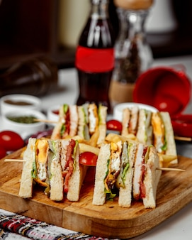 Club sandwich with side fries and coca cola