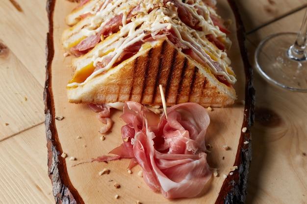 Club sandwich on wood tray